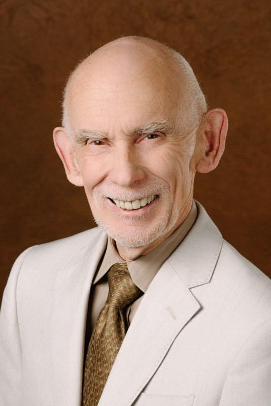 John Metcalf in a light brown suit